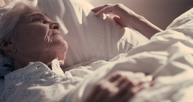 Elderly Woman laying in bed